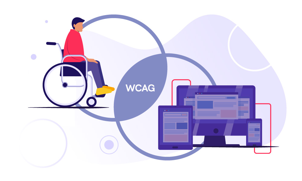 A person in a wheelchair next to a personal computer, mobile phone, and tablet