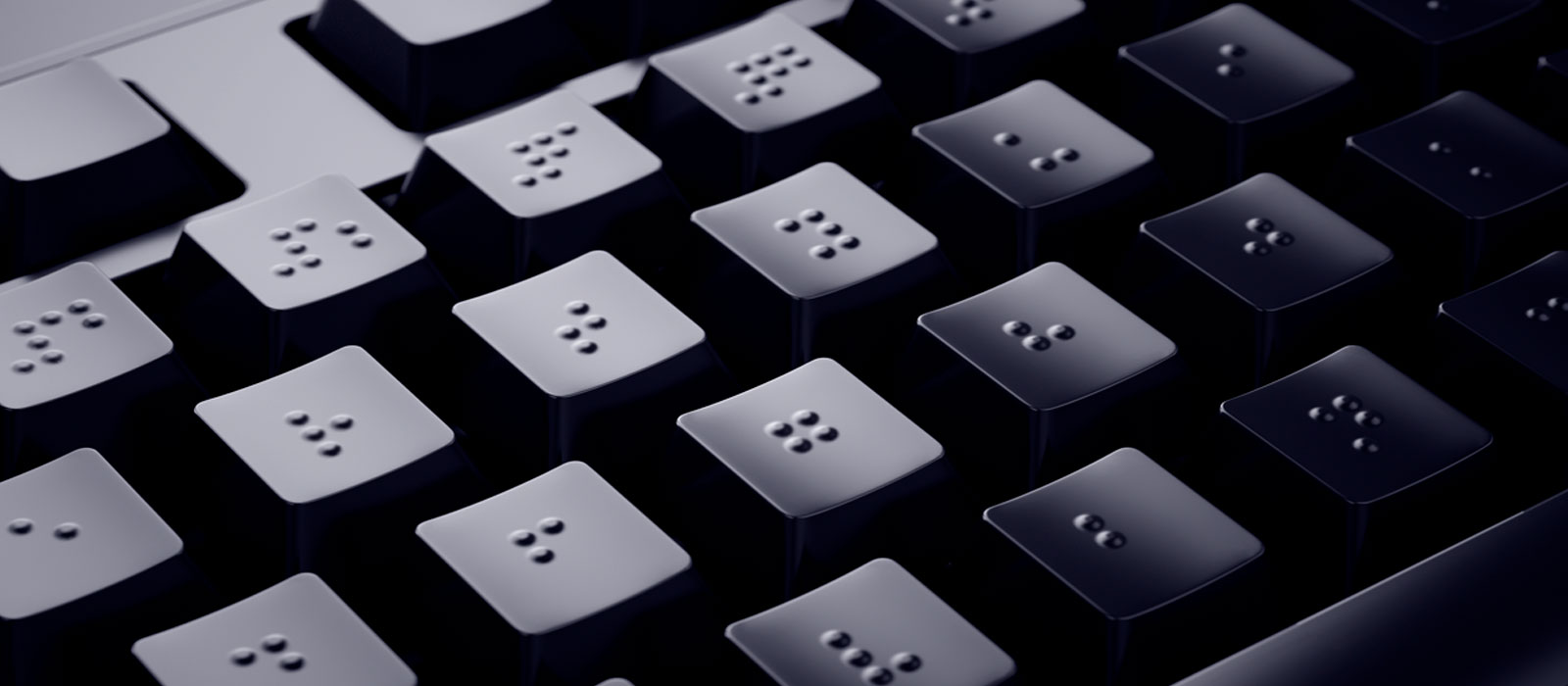 A black keyboard with special marks for the visually impaired