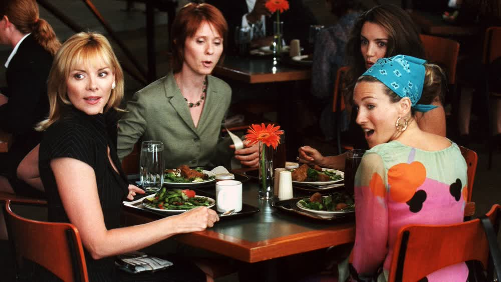 Four characters of the popular series sitting at the table