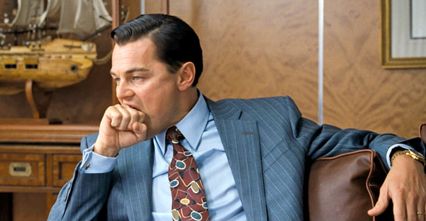 Leonardo DiCaprio bites a fist in Wolf of Wall Street
