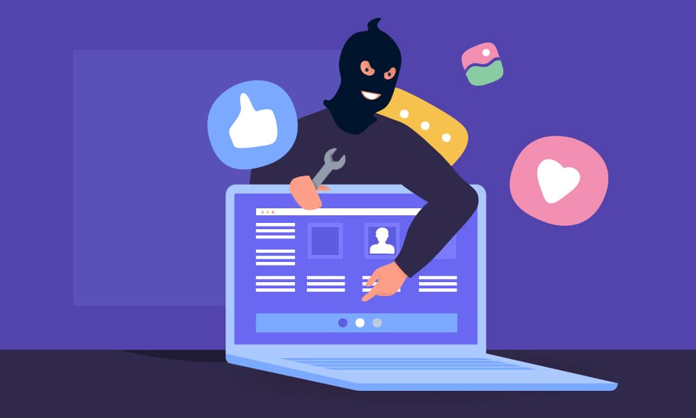 A hacker in a mask holding a wrench and pointing to an open social media page on a laptop