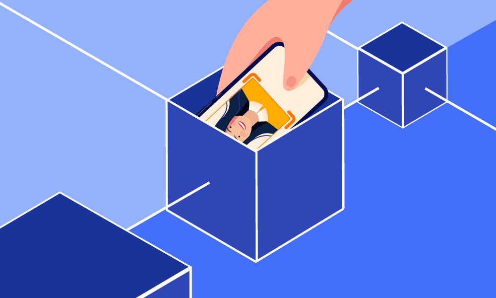 A person putting a mobile phone into a box symbolizing blockchain