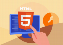 A human hand pointing at the HTML logo on a computer monitor