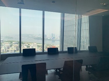 Panorama view on the conference room and city sights outside the window