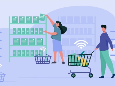 Four people carrying trolley and shopping baskets and choosing goods