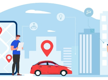 Two people next to a building and car filled with IoT sensors