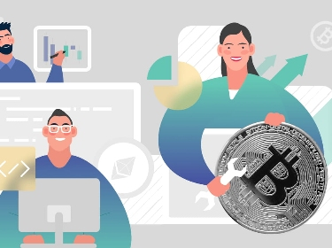 People developing an API next to a bitcoin physical coin
